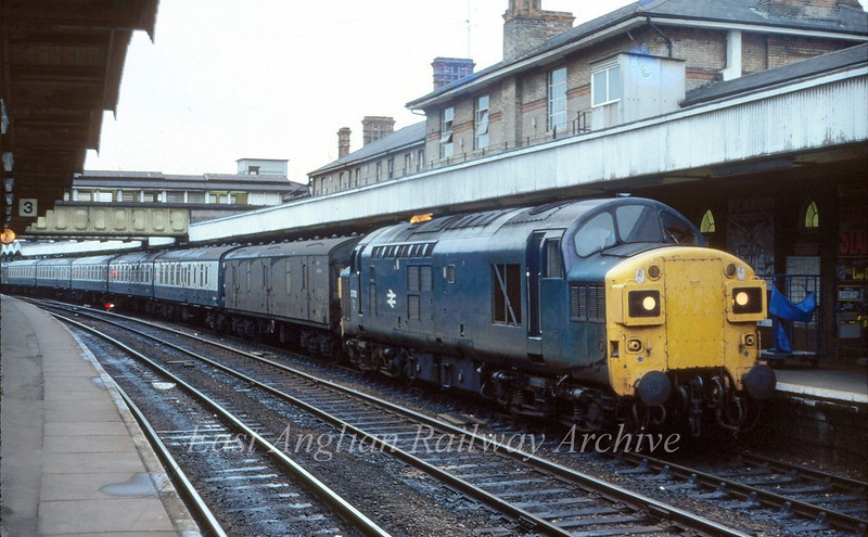 37092 waits at Ipswich with the 1638 Peterborough to Parkeston Quay.  8th July 1980