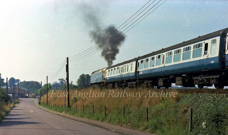 47011 emits plenty of clag as it leaves Diss with the 1032 Norwich to Liverpool Street on 29th August 1979.