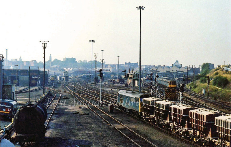 Norwich Thorpe Station viewed from Carrow Road Bridge. 31269 is arriving with a train of cement wagons. 6th September 1979.