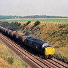 37060 at Belstead Bank South of Ipswich heading South with tanks.  1st September 1980