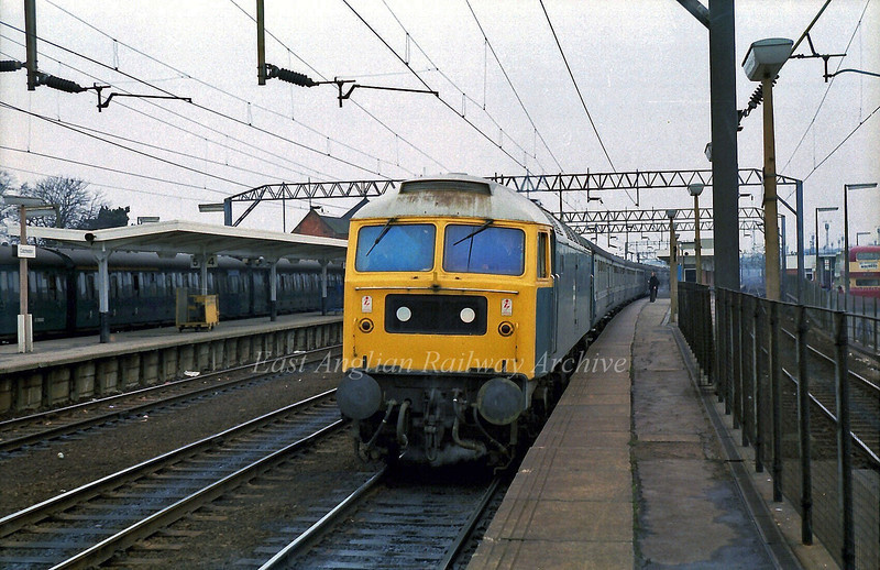 47010 stands at Colchester on the 1330 Liverpool Street to Norwich.  15th February 1980.