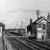 Buckenham Station on 22nd June 1977. At the time the signal box was redundant, the signals protecting the crossing controlled by a ground frame.