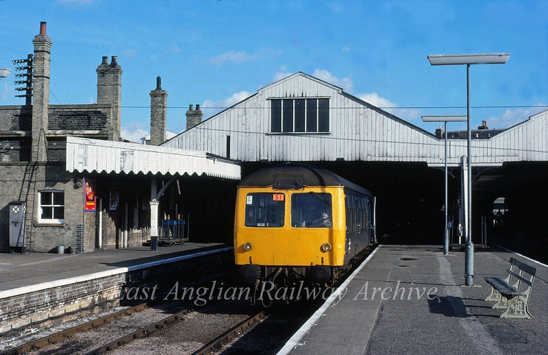 A two car Cravens unit stands at platform 3 at Lowestoft on a Norwich working in August 1982. The station still had its supurb overall roof.