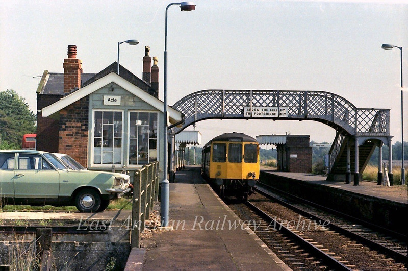 1143 Norwich to Yarmouth stands at Acle.<br /> 6th September 1979