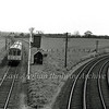 The 1023 Yarmouth to Norwich approaches Reedham Junction from the Berney Arms direction on 17th May 1977. The lines to Lowestoft diverge to the right.