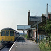 Gloucester RCW dmu forming the 1230 Yarmouth to Norwich stands at Lingwood.  6th September 1979
