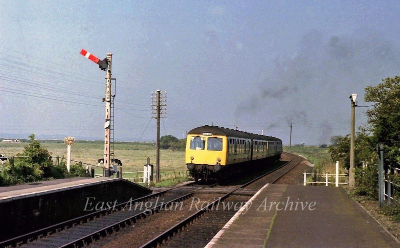 1115 Lowestoft to Norwich departs from Somerleyton towards the swing bridge. 6th September 1979 The swing bridge signal box conntrolled the signals at the station.