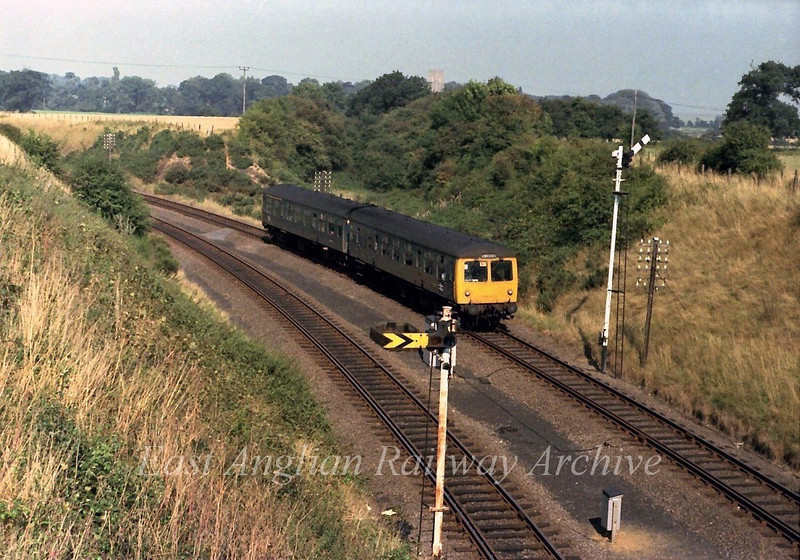 1400 Norwich to Lowestoft heads away from Reedham. Behind the dmu set can be seen the remains of Reedham East Curve which provided a direct link between Yarmouth and Lowestoft.  6th September 1979