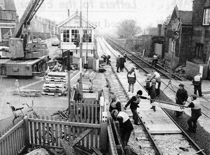 Oulton Broad North.  Relaying the crossing. c1977.