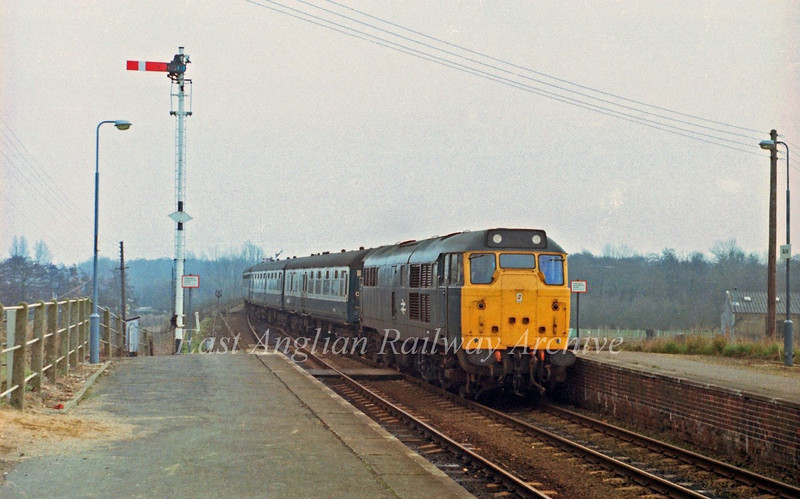 31113 passes Acle in charge of the 0858 Yarmouth to Liverpool Street.  1st March 1980