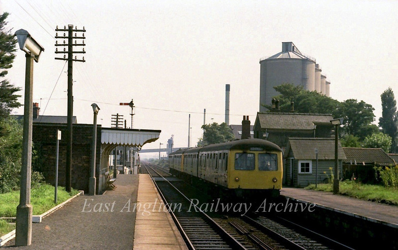 1226 Lowestoft to Norwich stands at Cantley with the sugar beet works in the background.  6th September 1979