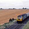 47192 approaches Brundall on the single track from Lingwood and Acle with the 1415 Yarmouth to Derby.  30th August 1980