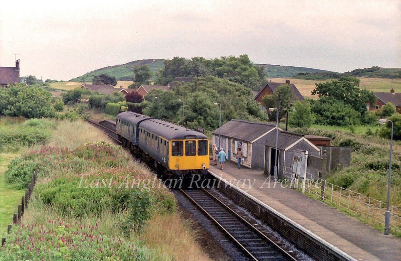 The 1311 Sheringham to Norwich loads a few passengers at West Runton. 16th July 1979.