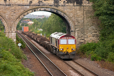 EWS has made inroads into the container business and here is 66044 working one such train, 6D97 1244 Wakefield Europort to Doncaster Intermodal. The train is very lightly loaded.