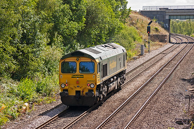 The board is against the loco so the driver will be moving slowly now to stop short of the signal O297.