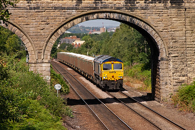 66712 is nicely framed by the tall road over bridge.