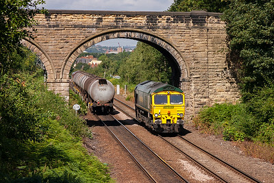 Freightliner 66552 passes below the road overbridge at Oakenshaw heading south possibly from Leeds Midland Road depot. To the left is the rear of the previous oil train.