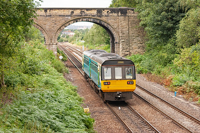 Northern Rail class 142 Pacer unit 142096 bounces its way past and will arrive at Wakefield Kirkgate station in a few minutes time. It left Knottingley at 1156, 2F70.