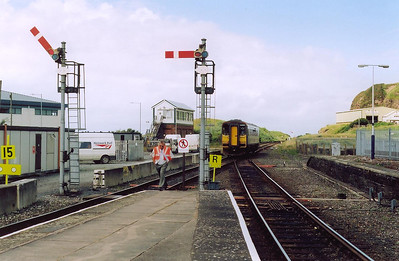 Amongst the modern buildings to the left, Whitehaven retains its former Furness Railway signalbox and semaphore signalling.  153330 has departed from the bay platform on the left with 2C35 1405 off to Carlisle.  The line to the right continues south down the coast.