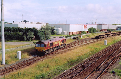 More freight and here the location is Workington yard and in the lovely morning sun, 66013 runs round its train, 6C17 0620 Carlisle Yard to Workington Docks.