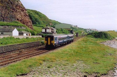 156427 in First Group livery gets away from Whitehaven heading northwith 2C37 1354 Barrow in Furness to Carlisle.  The train is approaching Redness Point and there is a great deal of industrial archeology in this area.