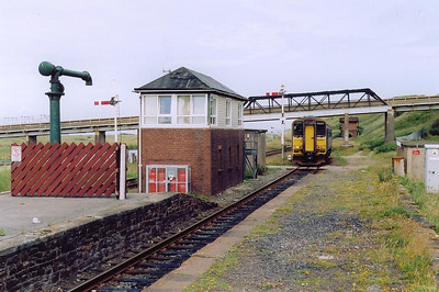 Sellafield now and what a gem of a station.  The station restoration was paid for by the nearby BNFL plant.  It retains its water cranes and tower, semaphore signalling and of course signalbox all which are visibl ein this shot.  153360 runs in for its stop with 2C30 1021 Carlisle to Barrow in Furness.