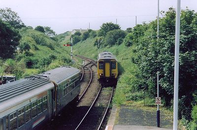 With the up train in the station, a down working runs in with 156466 forming 2C31 0858 from Lancaster to Carlisle.  The grass area to the side of 156466 is part of the platform meaning the station was once used to longer trains.
