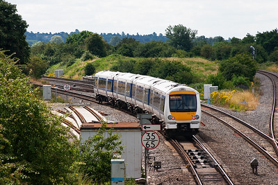 Another Chiltern Trains unit swings left at Aynho Junction, 168215 forms 1H33 1052 Birmingham Snow Hill to Marylebone.
