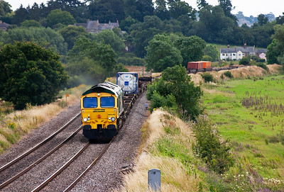 66540 lifts a lightly loaded, just three containers, 4M58 1100 Southampton to Ditton freightliner past Kings Sutton.