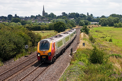 Unknown class 221 Super Voyager passes to the north of Kings Sutton forming 1S62 1046 Bournemouth to Edinburgh XC. The Church of St. Peter and St. Paul dominates the scene from the popular road over bridge just north of the town.