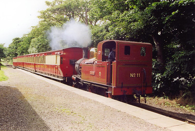The sun kissed platform of Port St Mary sees No 11 roll in with the 1600 from Port Erin.