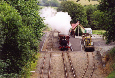The driver of No 11 opens up his charge as he passes through the request stop at Santon. This station has had platforms built and track relaid since 1999 and is a delightful station. This train is the 1400 Douglas to Port Erin.