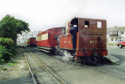 The fireman on No 11 looks out as the driver propells the brake coach back onto the rake standing in the platform. It took a coach from the set to strengthen its own train in the bay, due to a large influx of passengers at Port Erin.