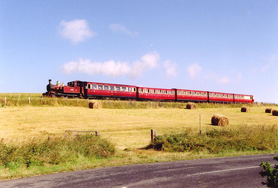 In perfect lighting, No 11 tops the climb from Douglas near Keristal with the 1000 departure. A fifth coach had been added at the last moment to accommodate a road coach of passengers.
