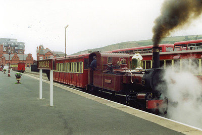 One coach has been removed from the rake of four as No 1 drops down onto the other two with a coach to make up a rake of three.