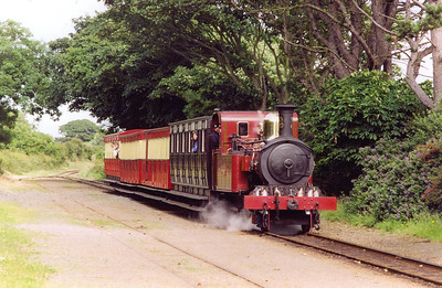 No 12 rolls into Colby with the 1620 from Douglas. The station has a loop but nothing crosses here. All trains use the down loop.  23/7/2001