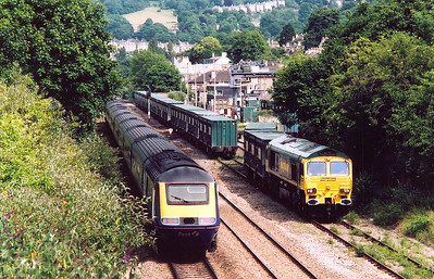 An up HST service passes 66527 as it goes about its aromatic business.  The passenger train is 1A24 1600 Bristol to London Paddington and it will be stopping shortly at Bath Spa station.
