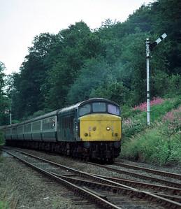 45107 09.05 Liverpool Scarborough approaching Kirkham Abbey 8/8/85
