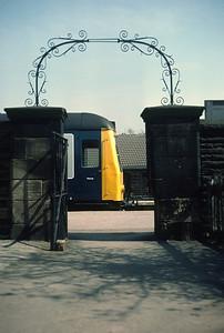 Class 108 DMU seen through entrance arch at Guisley, April 1982