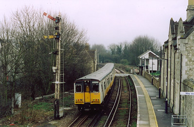 Aylesford up starter and tall lattice post is seen from the footbridge as 508211 passes and enters the next section, as it did the distant arm fell on. The train is 2T42 1230 Strood to Maidstone West.  At the end of the down platform is the 1921 built signalbox.