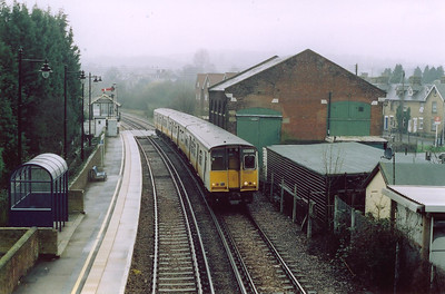 In 2005 semaphore signalling was clinging on along the Medway Valley line.  508202 enters Wateringbury on a damp and gloomy morning working 2T23 1003 Paddock Wood to Strood. The platforms here are staggered with the down platform behind me.  The goods shed is no longer in rail use.