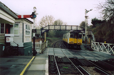 508201 is seen again as it slips away from the down platform at East Farleigh with a train from Paddock Wood to Strood, 2T37, 1101 off. The signalbox is almost tucked away out of sight on the end of the up platform.
