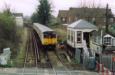 The next station north is the delightfully named Snodland. 508211 runs in beside the low signalbox at the level crossing with 2T47 1258 Maidstone West to Strood shuttle.  The former South Eastern Railway signalbox is of 1870s vintage and was taken out of use on 23rd June 2013.