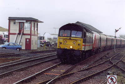The hills to the south are shrouded in cloud now as 47843 heads north with 1S11 0720 Euston to Glasgow Central. The signalbox was built by BR after water affected the foundations of the Midland 'box and it had to be demolished.
