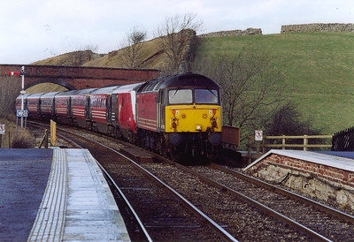The up Royal Scot passes below the occupation bridge to the north of Kirkby Stephen station. 47702 is in charge of 1M28 1050 Glasgow Central to Euston.