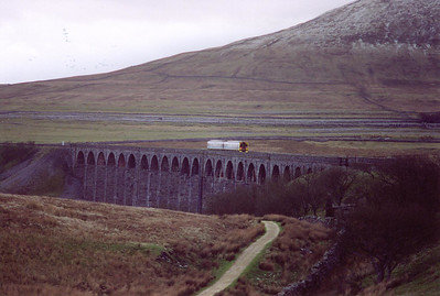 An unknown class 158 sprinter unit passes over Ribblehead Viaduct with a diverted 1M16 1228 SO Glasgow Central to Manchester Piccadilly working.