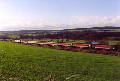 Following 47789 with the camera as it runs into the glint heading south near Langwathby.