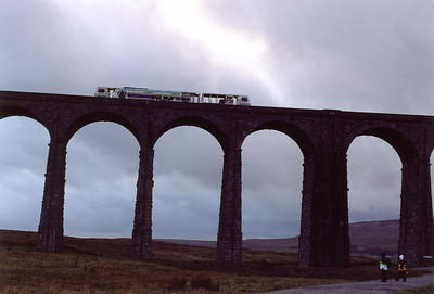 A great number of viaducts and bridges on the railway have plants growing from them. Ribblehead Viaduct as a piece of plant crossing it in the form of track maintenance vehicle DR7380-4.