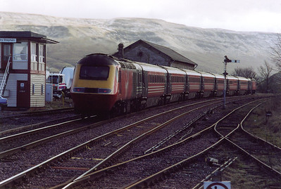 43121 is on the front with 43008 on the back of a diverted southbound long distance cross country working 1V52 0950 Glasgow Central to Penzance. A light dusting of snow lies on the hills to the south.