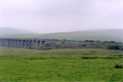 The second gypsum train of the day strides out over Ribblehead Viaduct with GBRf 66713 powering 4M52 0615 West Burton Power Station to Newbiggin. The gypsum is a by product of the desulphurisation process.